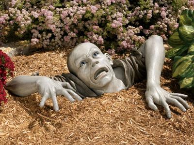 Rising zombie sculpture